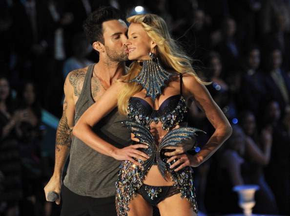Singer Adam Levine of Maroon 5 kisses model Anne Vyalitsyna