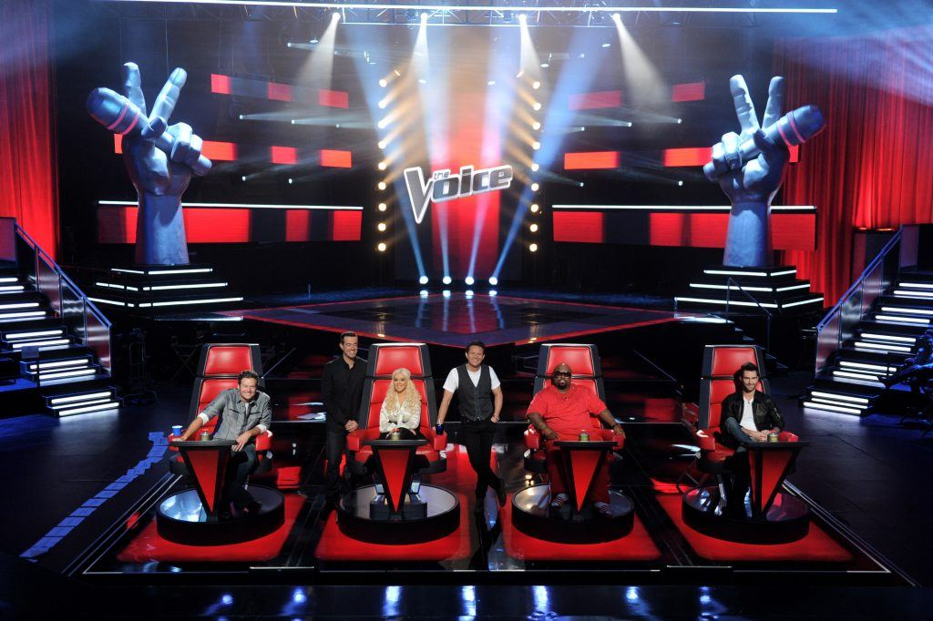 (L-R) Singer Blake Shelton, host Carson Daly, singer Christina Aguilera, executive producer Mark Burnett, singers Cee Lo Green and Adam Levine appear at a press junket for NBC's The Voice