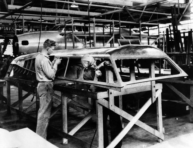 Boeing employees work on the fuselage of a war plane in 1937