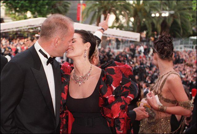 Bruce Willis and Demi Moore kiss at the top of the steps of the Palais des festivals