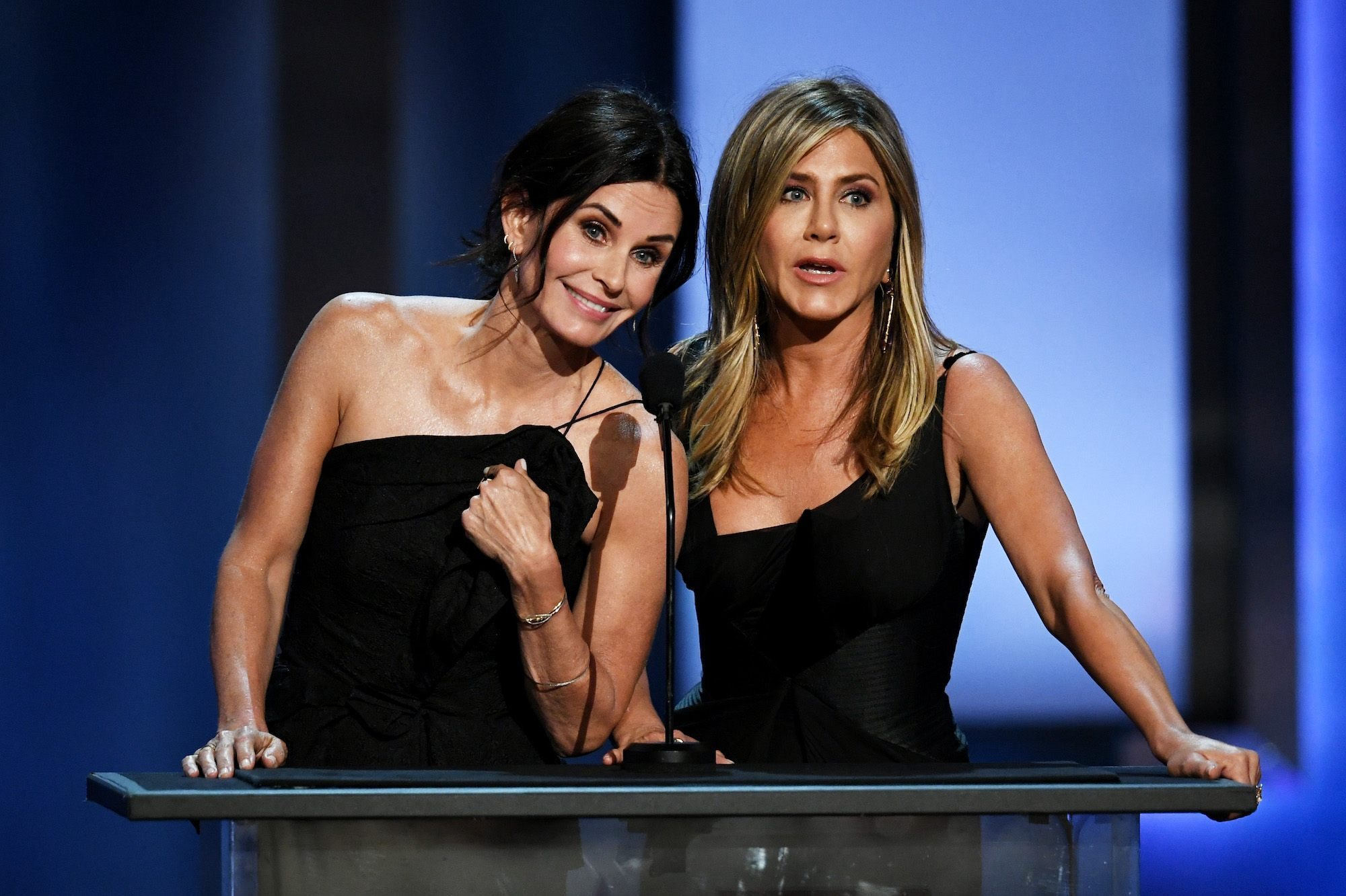 Courteney Cox (L) and Jennifer Aniston speak onstage during the American Film Institute's 46th Life Achievement Award Gala Tribute to George Clooney