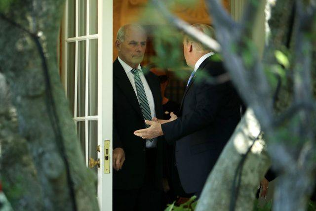 Donald Trump talks with his Chief of Staff John Kelly before departing the White House
