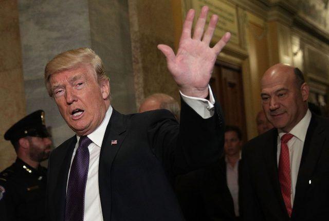 Donald Trump waves as he arrives at the Capitol