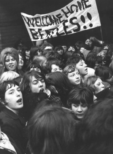 Fans welcome The Beatles home from their tour of the United States