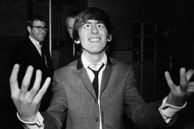 George Harrison tries out a pair of false eyes made by Madame Tussaud's