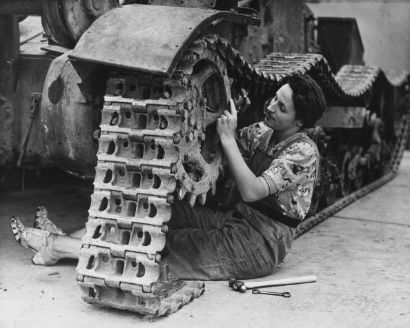 A woman fixing a track