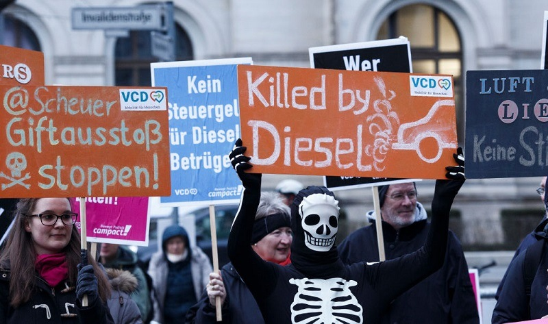 Protesters show banners during a bicycles protest against the ongoing diesel affair in front of the Transport Ministry on the day new Transport Minister Andreas Scheuer took office on March 14, 2018 in Berlin, Germany. A German court recently ruled that cities may impose bans on diesel cars in order to bring down air pollution. Many diesel car owners are furious at German automakers, particularly Volkswagen, following the illegal software scandal that enabled diesel cars with high emissions to still pass emissions tests. Public confidence in diesel technology in Germany has plummeted as some critics even predict the demise of the technology altogether.