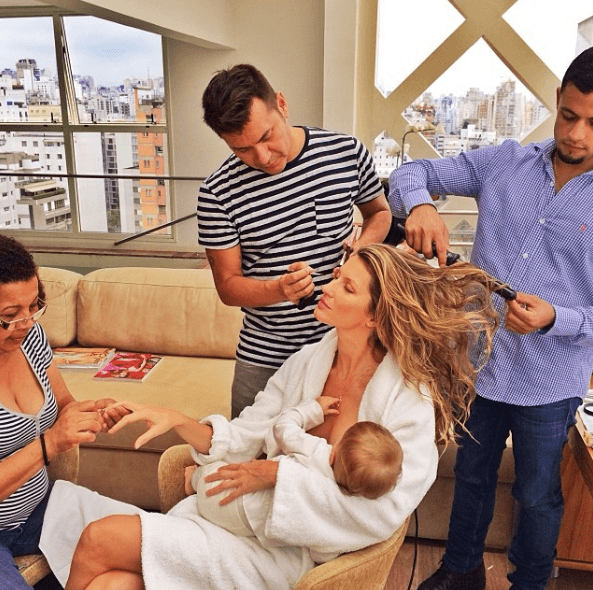 Gisele Bundchen breastfeeding while getting her hair and makeup done