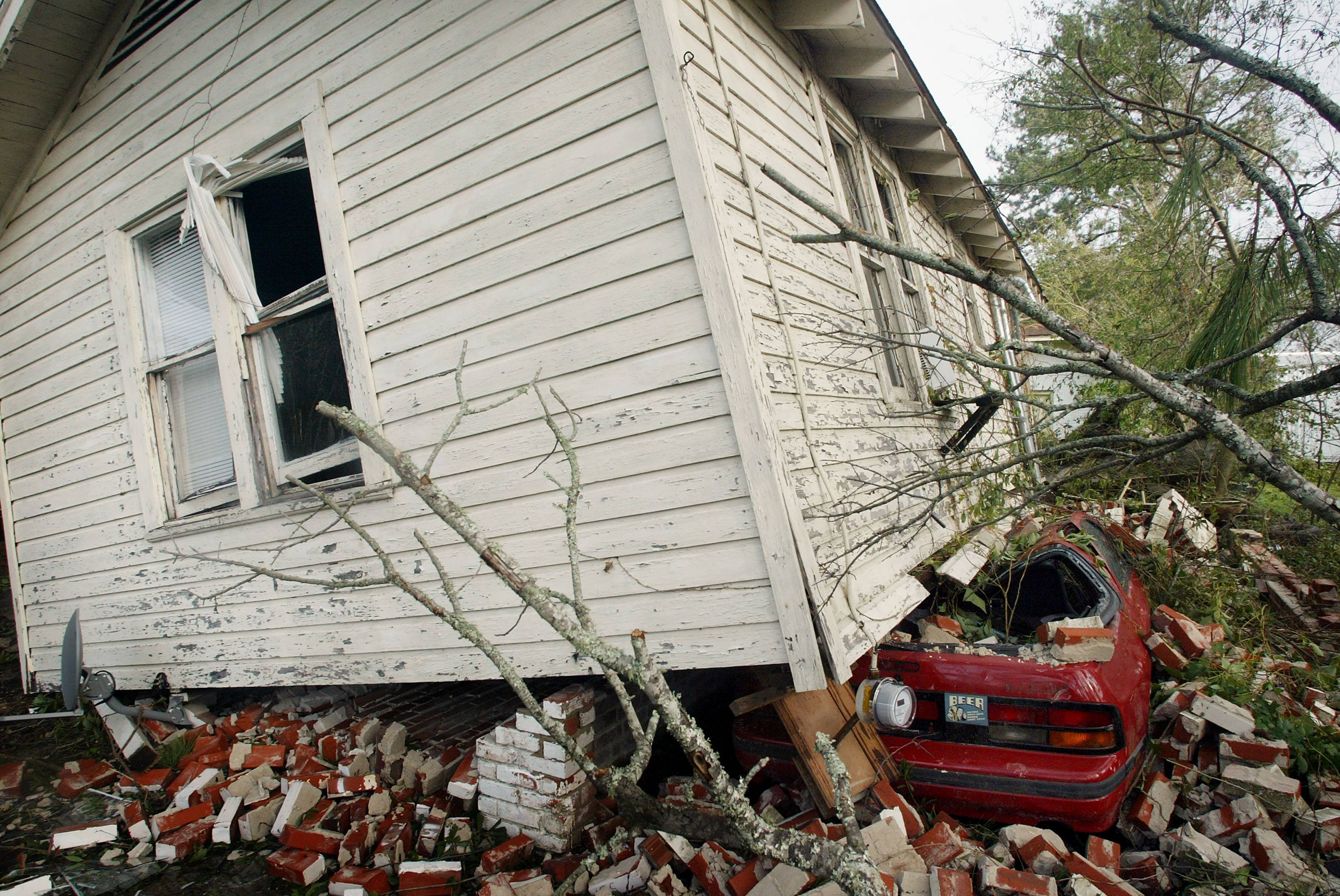 A house rests on top of a car in Lake Charles, La., after Hurricane Rita in 2005.