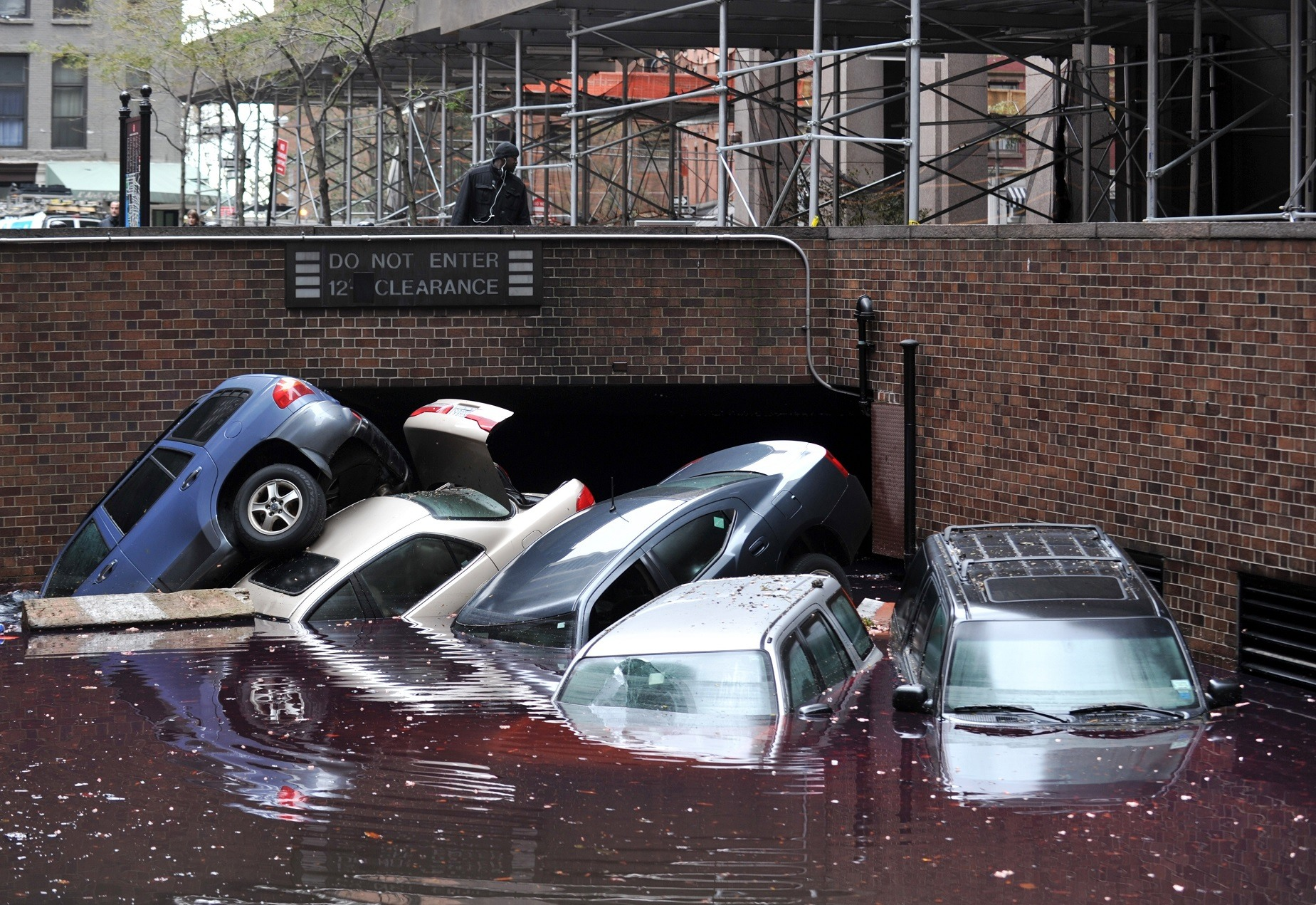 Hurricane damage from superstorm Sandy in Manhattan, NY -- That's not how cars are supposed to be