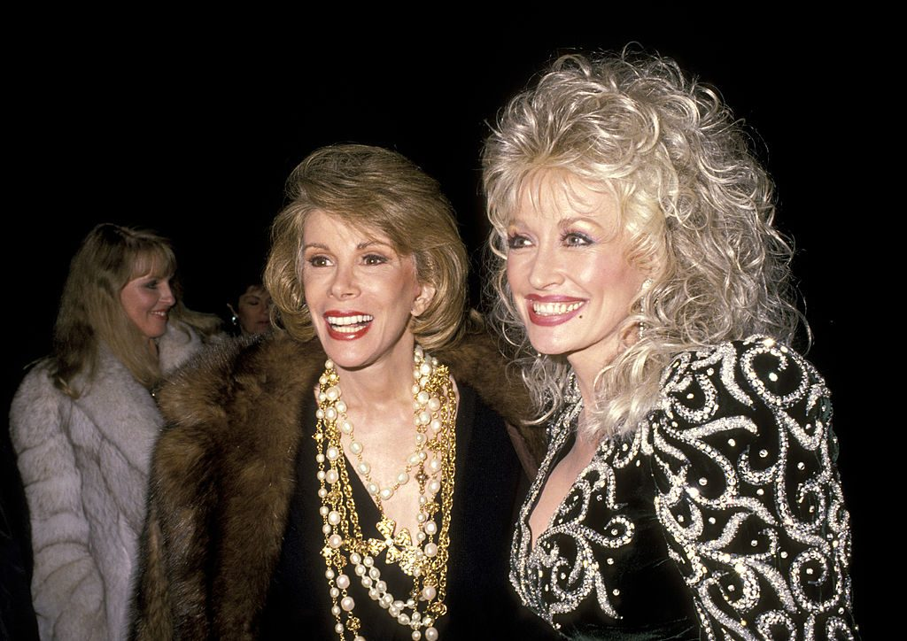 Joan Rivers and Dolly Parton at a Christmas party in 1988.