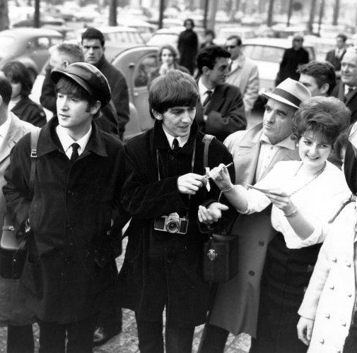 John Lennon and George Harrison sign autographs in Paris