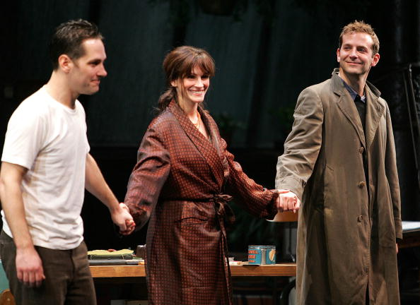 "Actors Paul Rudd, Julia Roberts and Bradley Cooper appear onstage during curtain call at the opening night of ""Three Days of Rain"" at the Bernard B. Jacobs Theatre on April 19, 2006 in New York City"