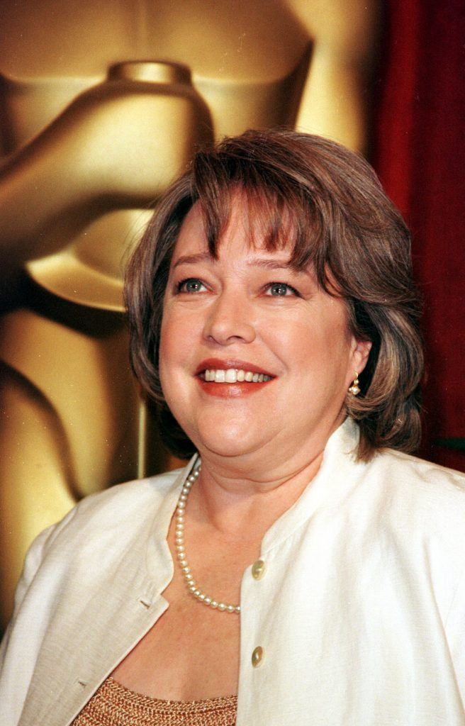 Kathy Bates poses with a large Oscar statue March 8, 1999