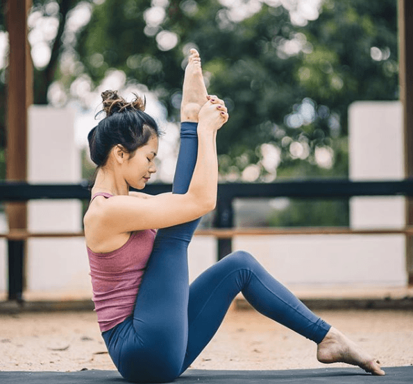 Yoga teacher wearing Lululemon high-waisted pants