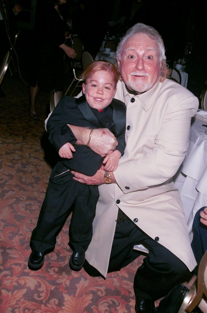 Comedian Marty Ingels, right, gives actor Josh Ryan Evans a squeeze at The Fifth Annual Golden Satellite Awards in 2001.