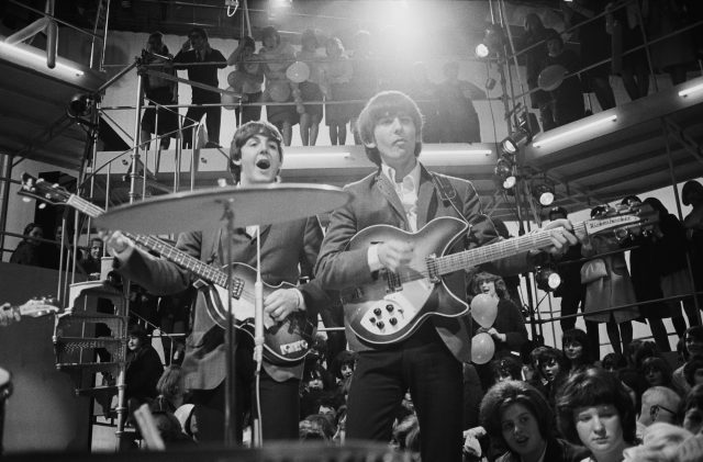 Paul McCartney and George Harrison play at a rehearsal for the 'Round The Beatles' TV show
