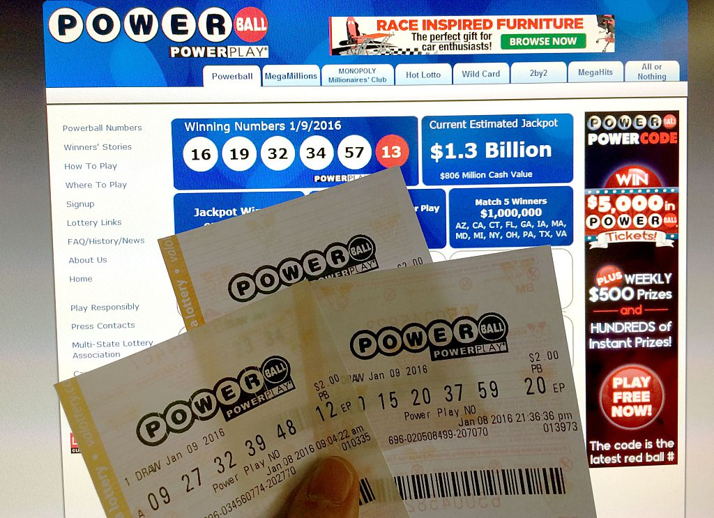 Person holding Powerball lottery tickets