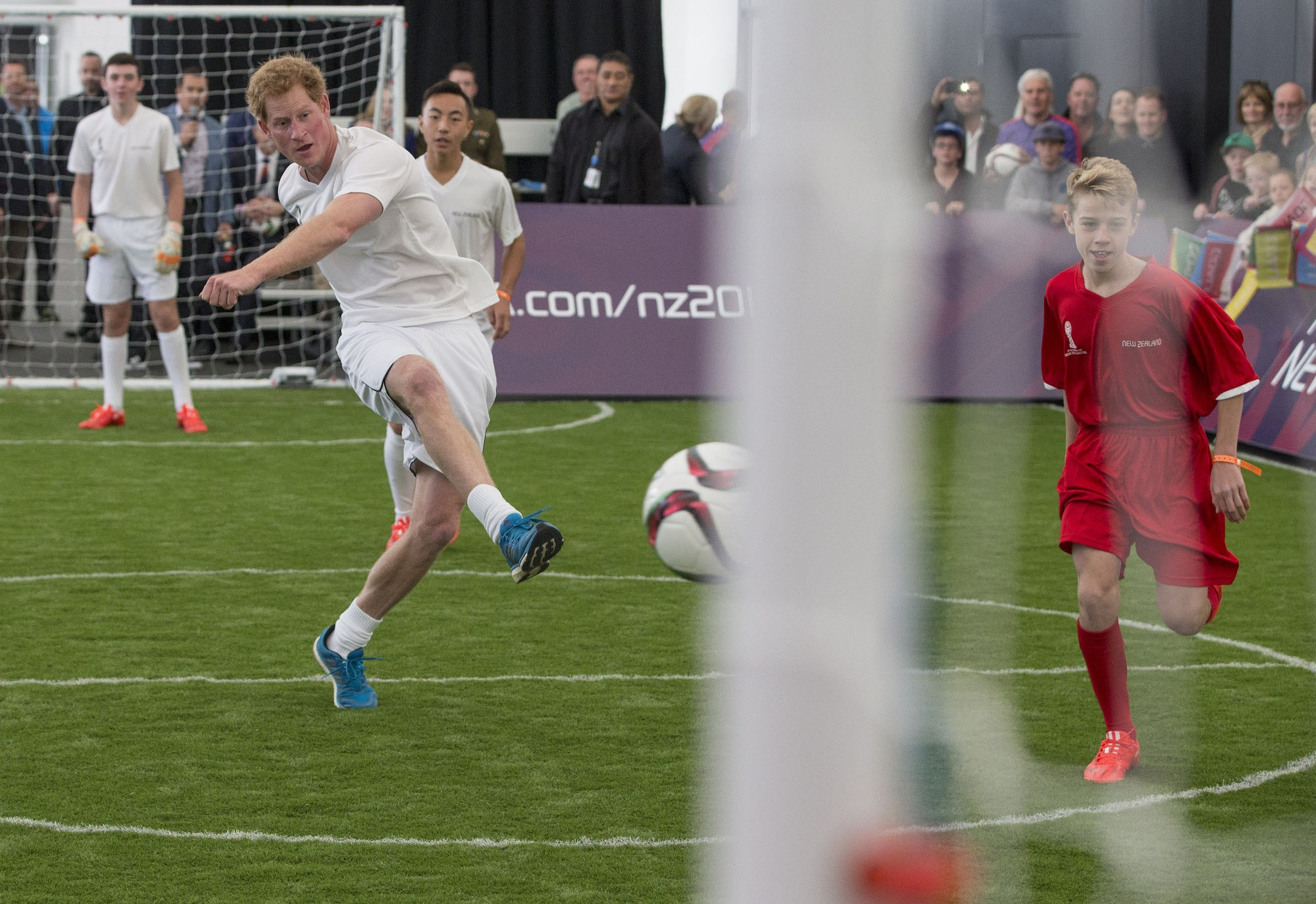 Prince Harry playing soccer