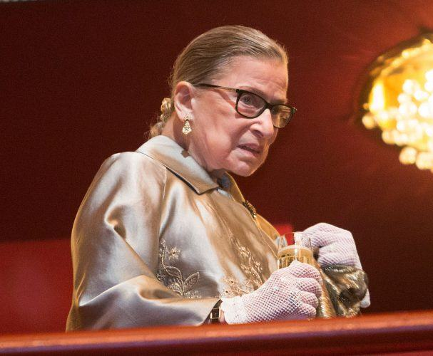 Supreme Court Justice Ruth Bader Ginsburg takes a refreshment during intermission at The Kennedy Center Honors 2015