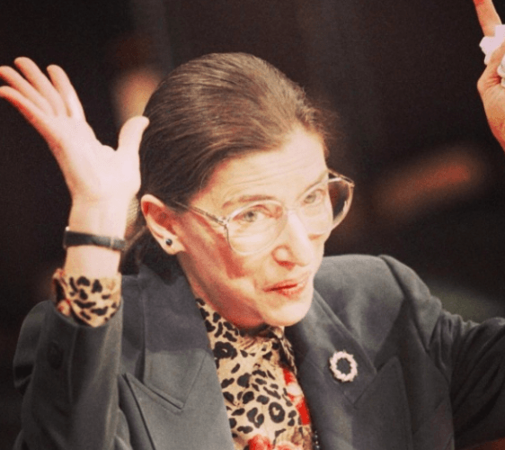 RBG with her hands up