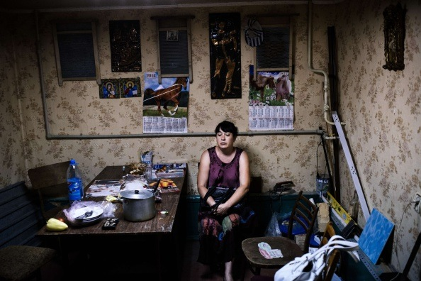 A woman sits inside a makeshift bomb shelter in Donetsk, on August 10, 2014.