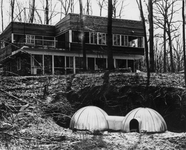 A two-unit fallout shelter of the kind recommended by the U.S. Civil Defense Office. It combines two steel igloo shelters and provides accommodation for six people