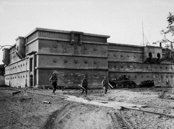 American troops in front of a vast air raid shelter
