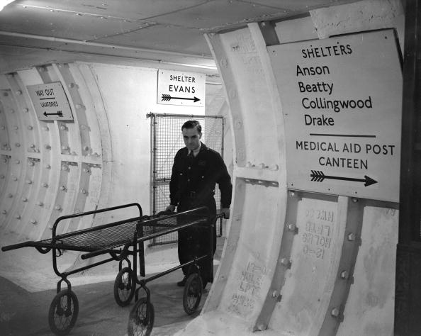 A man with a trolley stretcher in the London Underground shelters
