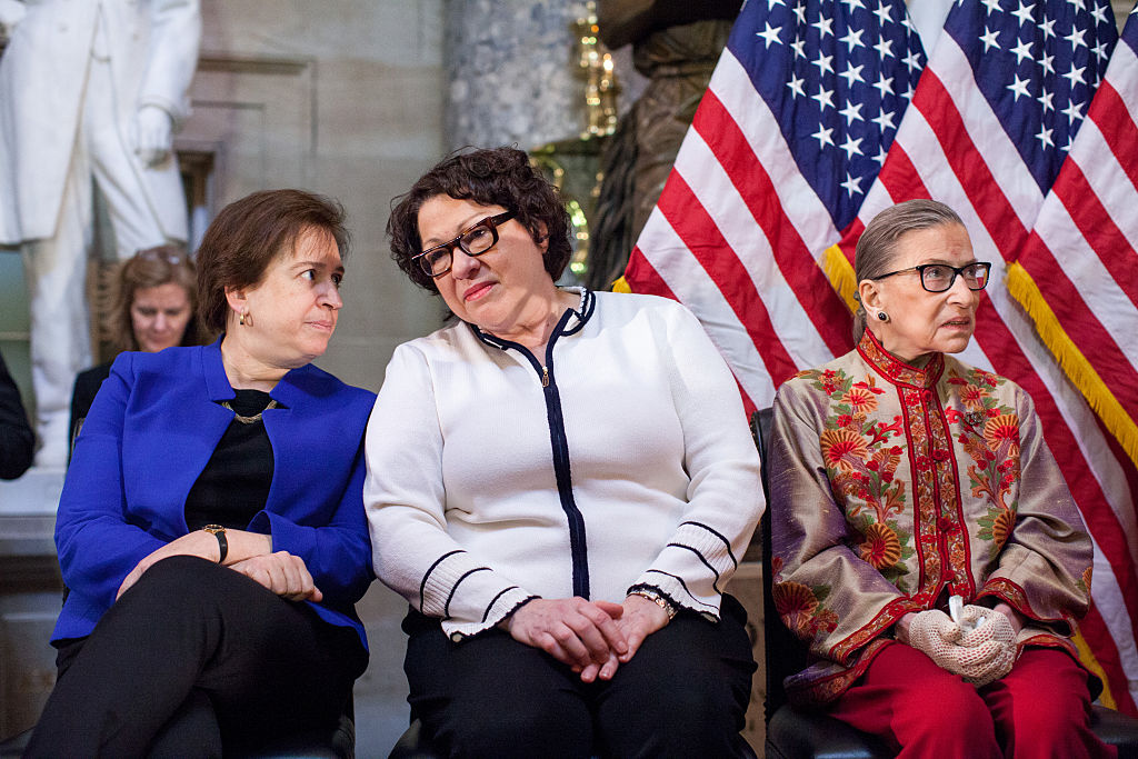 Justices Elena Kagan, Sonia Sotomayor and Ruth Bader Ginsburg, participate in an annual Women's History Month reception