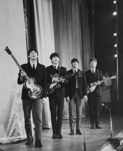 The Beatles take a bow on stage after performing in the Royal Command Performance