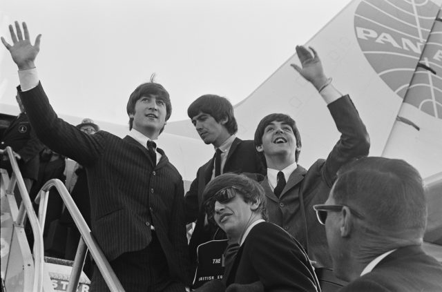 The Beatles wave at the crowd while in the US for their first US concerts