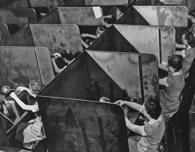 Women work in a tool factory in the 1940s