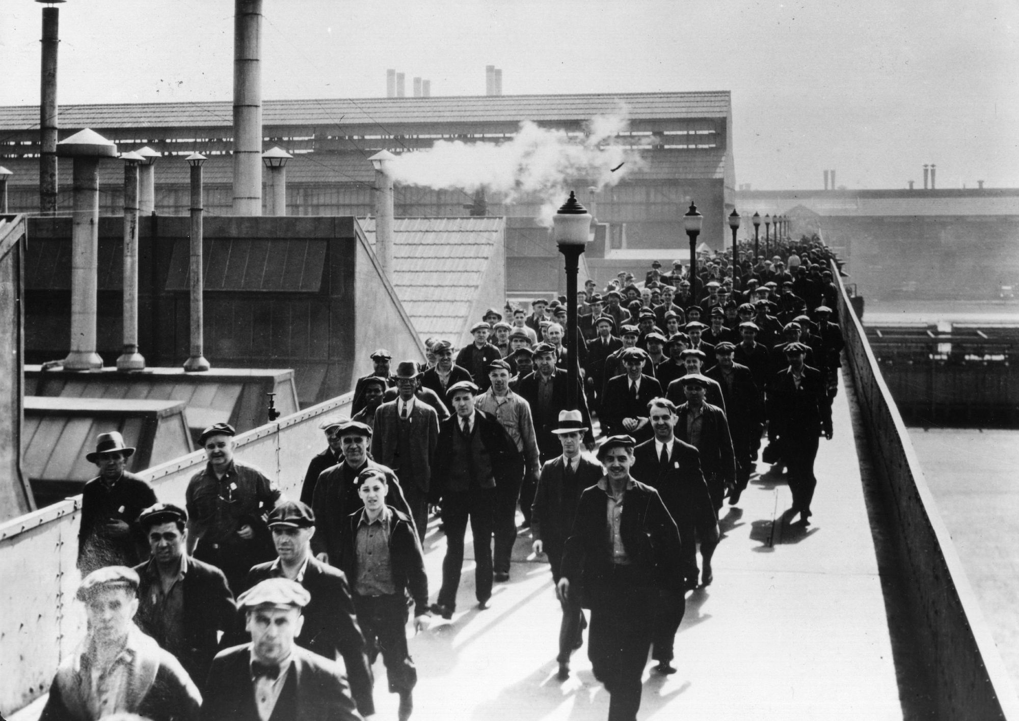 Workers leave the Detroit Ford Motor works circa 1930