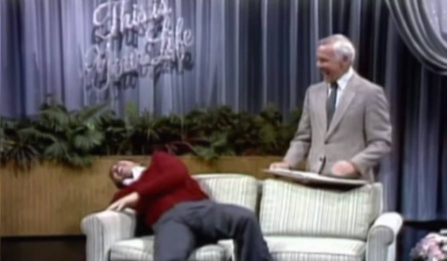 Burt Reynolds sharing a laugh with Johnny Carson