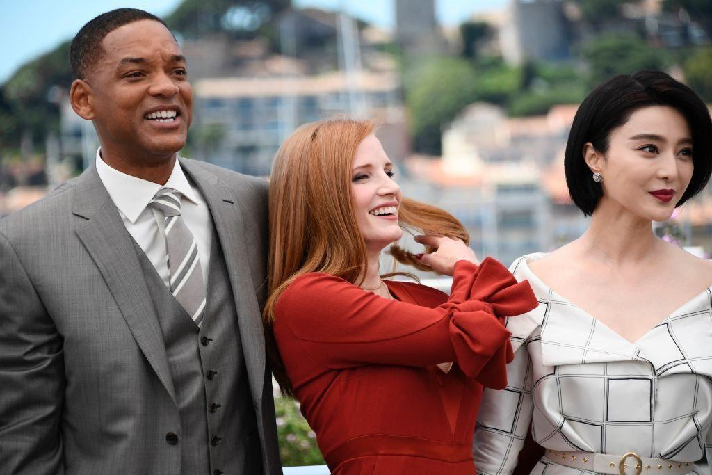 Fan Bingbing poses with Will Smith and Jessica Chastain at the 70th annual Cannes Film Festival