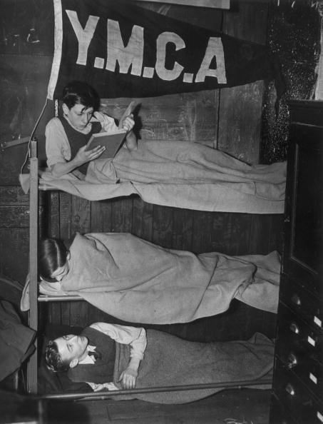 Boys tucked up in their bunk beds at the Bow Road YMCA Boys Club
