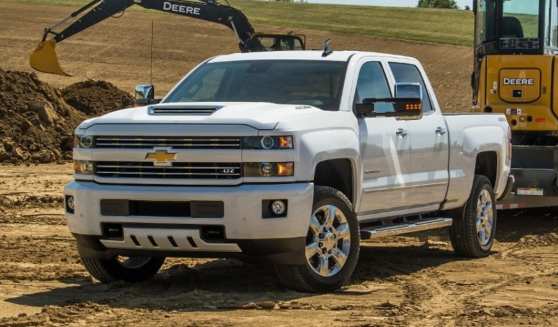 2018 Silverado 2500 HD White LTZ Custom Sport Crew Cab towing John Deere Compact Track Loader with a Big Tex Trailer. Towing 11,485 pounds (total weight of trailer and equipment combined).