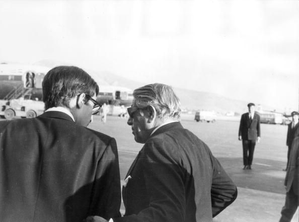 Greek shipping magnate Aristotle Onassis chats with his son Alexander at Athens Airport in 1970