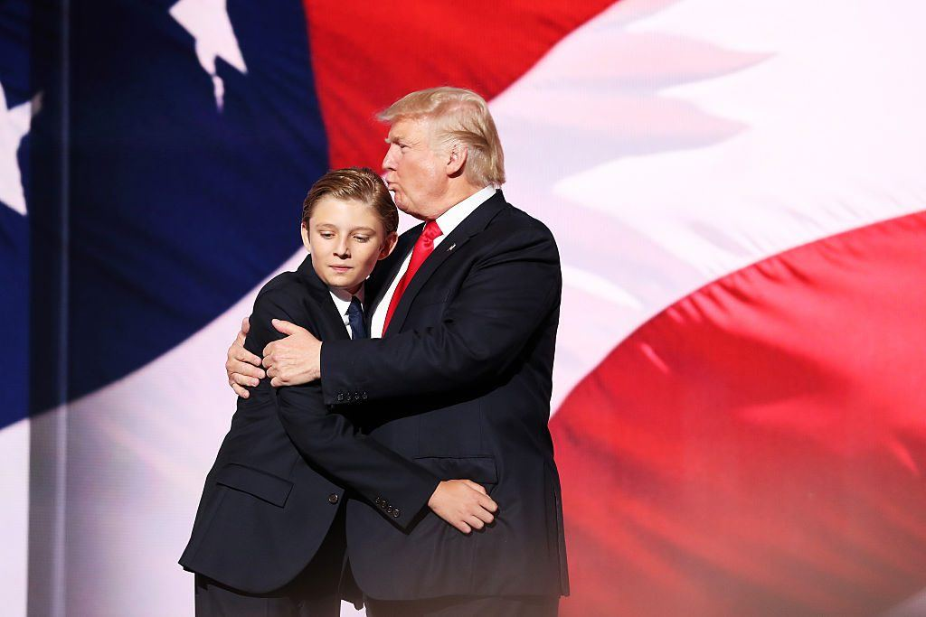 Donald embraces his son Barron Trump.