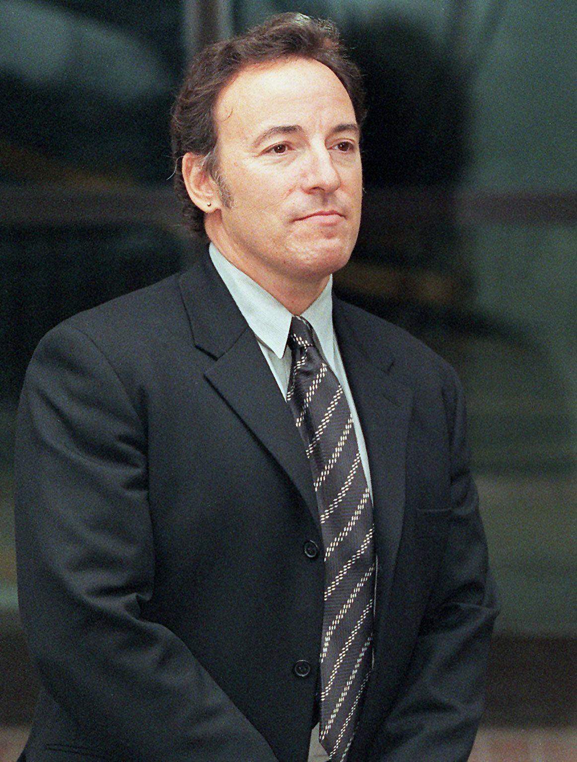Bruce Springsteen leaving British court