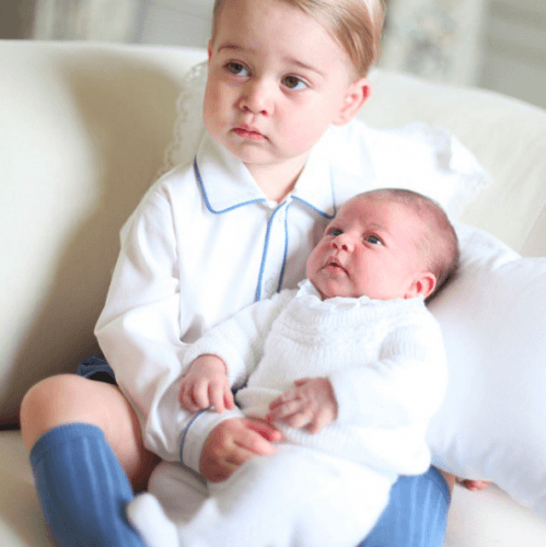 Prince George with baby Princess Charlotte