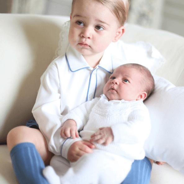 Prince George with baby Princess Charlotte