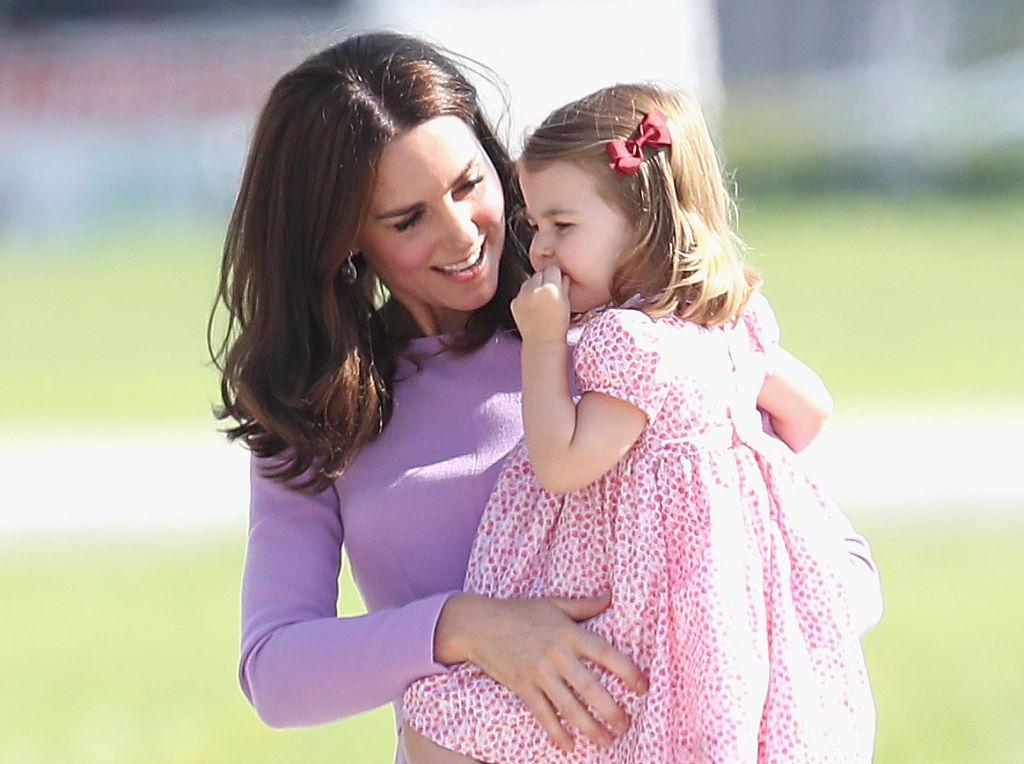 Kate Middleton holding her daughter, Princess Charlotte