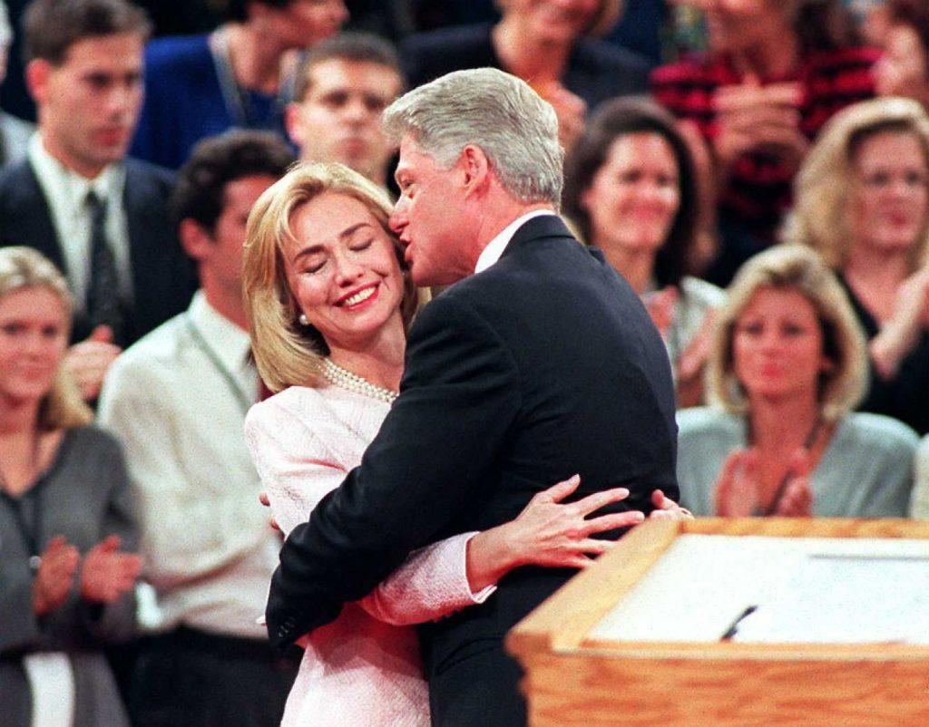 President Bill Clinton (R) gets a hug from Hillary Clinton