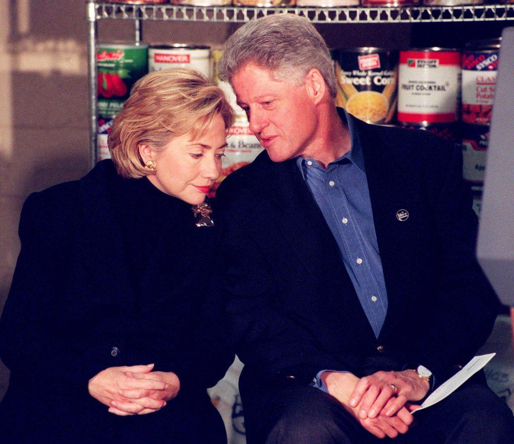 Bill Clinton (R) and First Lady Hillary Clinton (L) prepare to speak