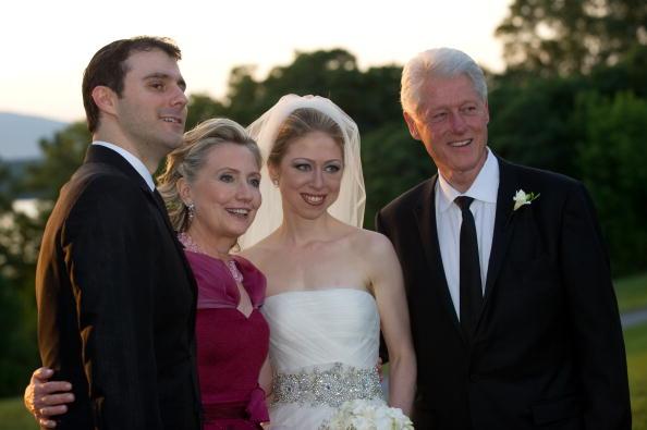 Hillary Clinton, Chelsea Clinton, and Bill Clinton pose during the wedding of Chelsea Clinton and Marc Mezvinsky.