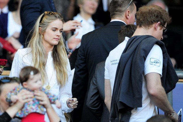 Prince Harry (R) and Cressida Bonas (L) take their seats during the RBS Six Nations match between England and Wales at Twickenham Stadium on March 9, 2014 in London, England