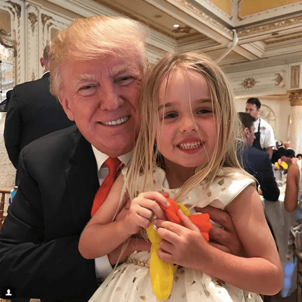 Donald Trump with his granddaughter
