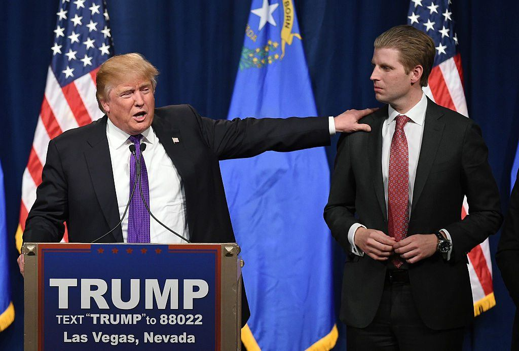 Donald Trump speaking with Eric Trump by his side
